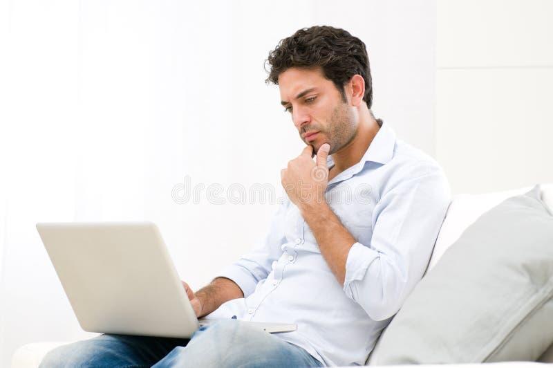 Download Pensive Worried Guy At Laptop Stock Image - Image: 22438527