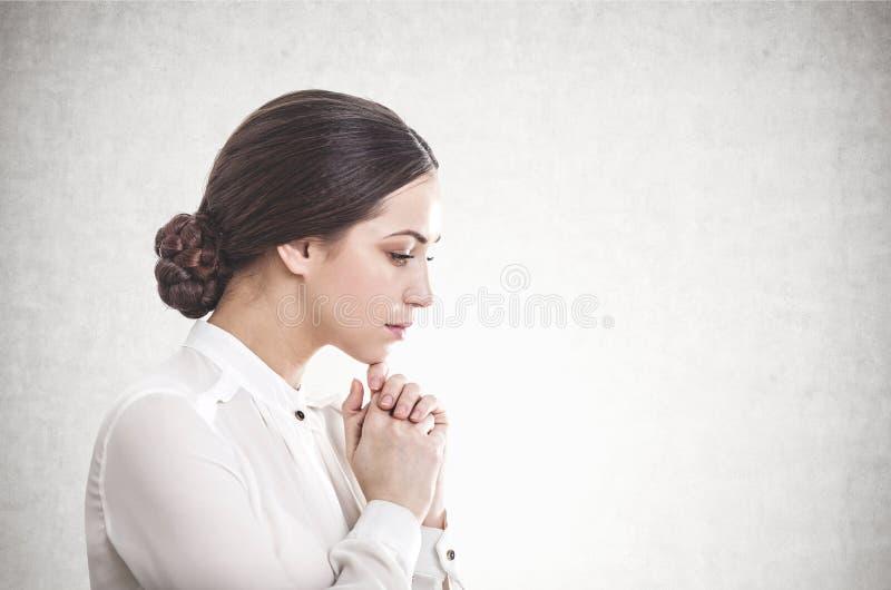 Pensive young businesswoman, concrete stock photos
