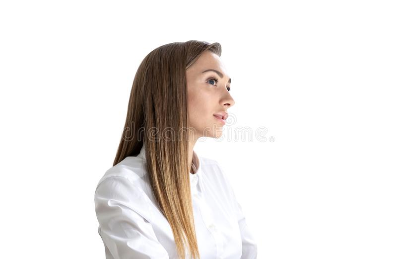 Pensive young businesswoman looking sideways stock images