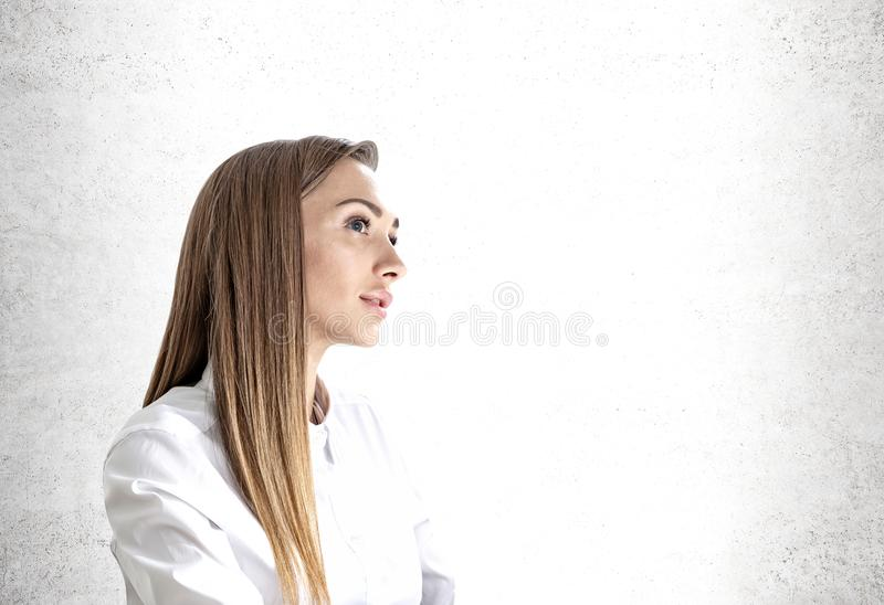 Pensive young businesswoman portrait, mock up stock images