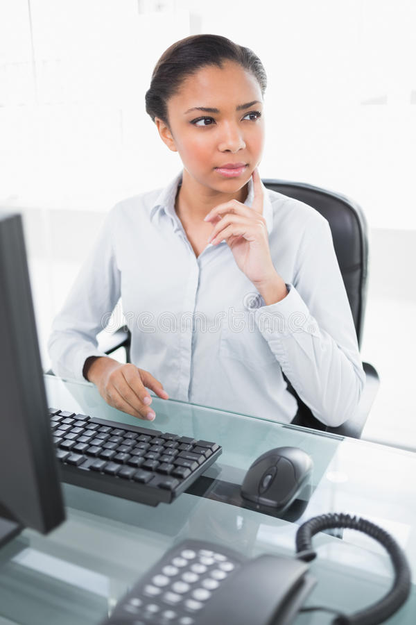 Download Pensive Young Dark Haired Businesswoman Looking Away Stock Image - Image: 34393525