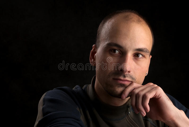 Pensive young man stock images