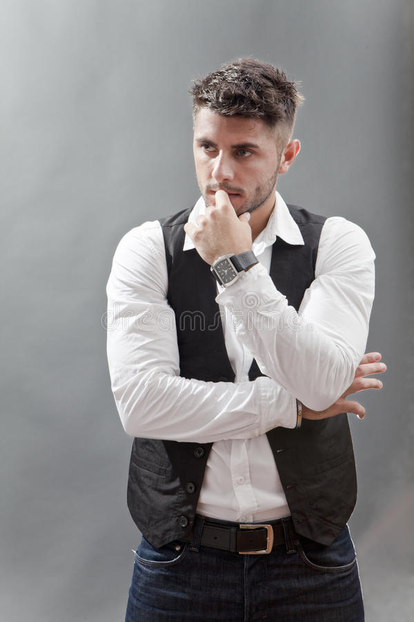 Pensive young man royalty free stock image