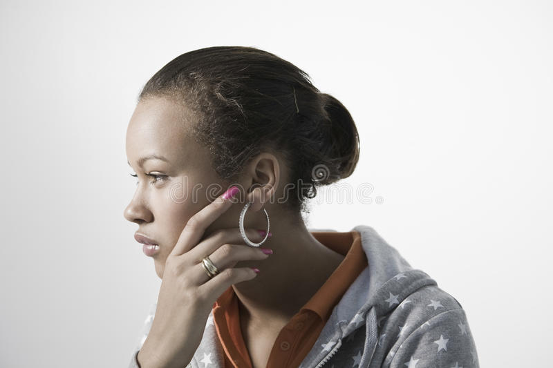 Pensive Young Woman Looking Away Stock Image