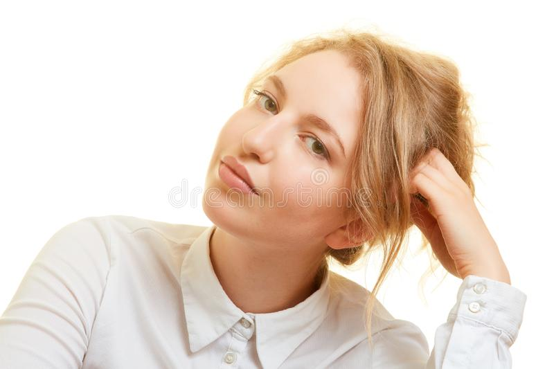 Pensive young woman is looking for solution for problem stock image
