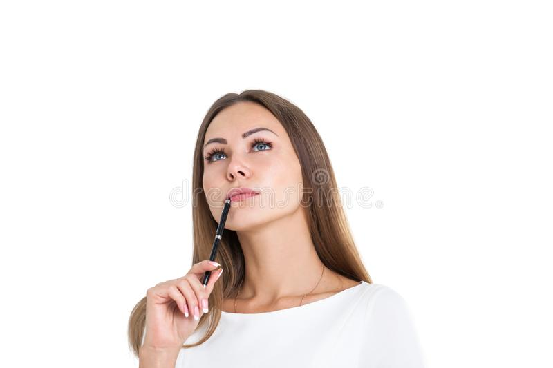 Pensive young woman with pen, isolated stock images
