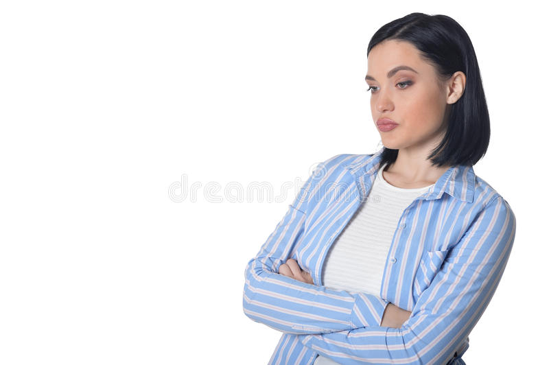 Pensive young woman. Portrait of pensive young woman isolated on white background stock photo