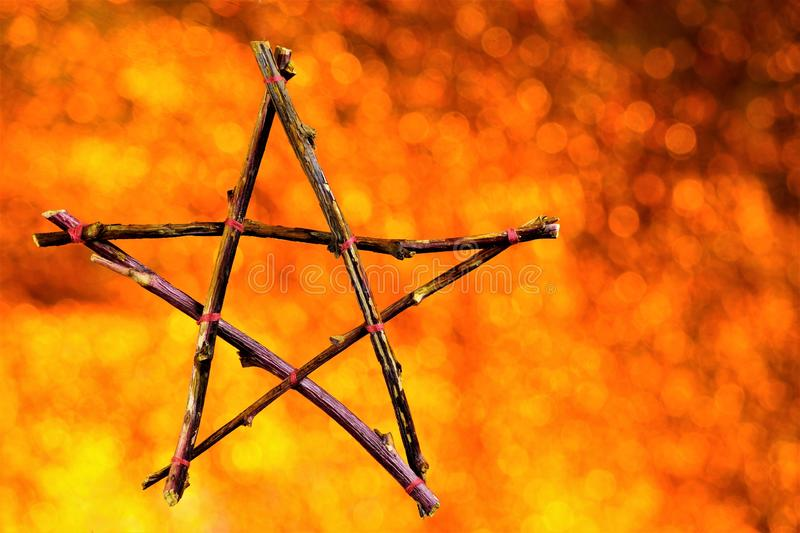 Pentagram of branches background Boke— five elements: Fire, Water, Air, Metal, Earth and Life. Pentacle symbol of the Goddess of royalty free stock photography