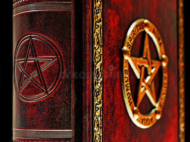 Pentagram embossed to the book spine with the gilded pentagram in the background.  royalty free stock photo