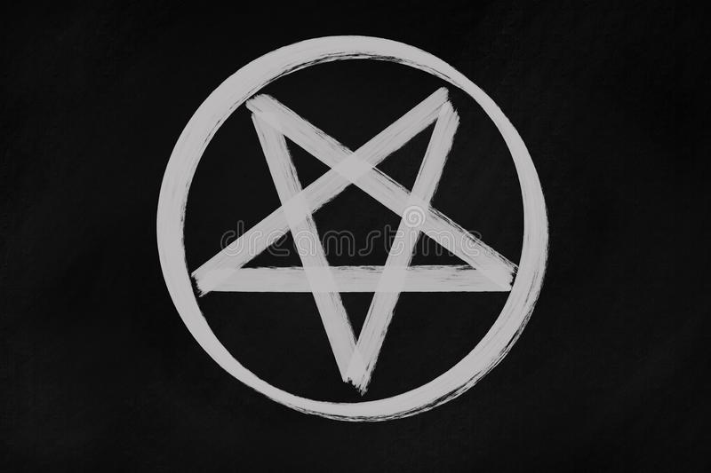 Pentagram icon chalk drawing on black chalkboard royalty free illustration