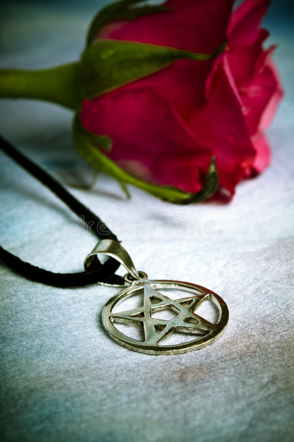 Pentagram and love. Romantic magic pentagram with red rose symbolized love and passion stock photography