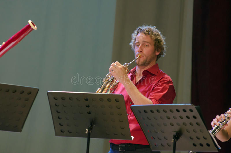 PentAnemos. DNIPROPETROVSK, UKRAINE - SEPTEMBER 25, 2015: Christian Loferer (French horn) - member of the woodwind quintet PentAnemos performs at the stock images