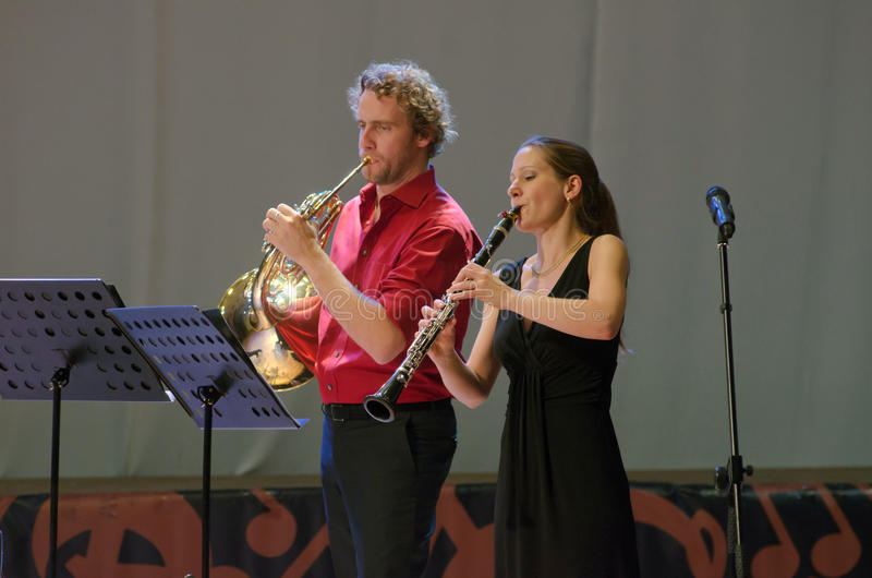 PentAnemos. DNIPROPETROVSK, UKRAINE - SEPTEMBER 25, 2015: Claudia Sautter (clarinet) and Christian Loferer (French horn) - members of the woodwind quintet royalty free stock photo