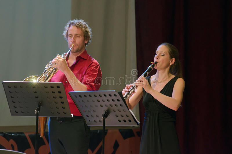 PentAnemos. DNIPROPETROVSK, UKRAINE - SEPTEMBER 25, 2015: Claudia Sautter (clarinet) and Christian Loferer (French horn) - members of the woodwind quintet royalty free stock photography