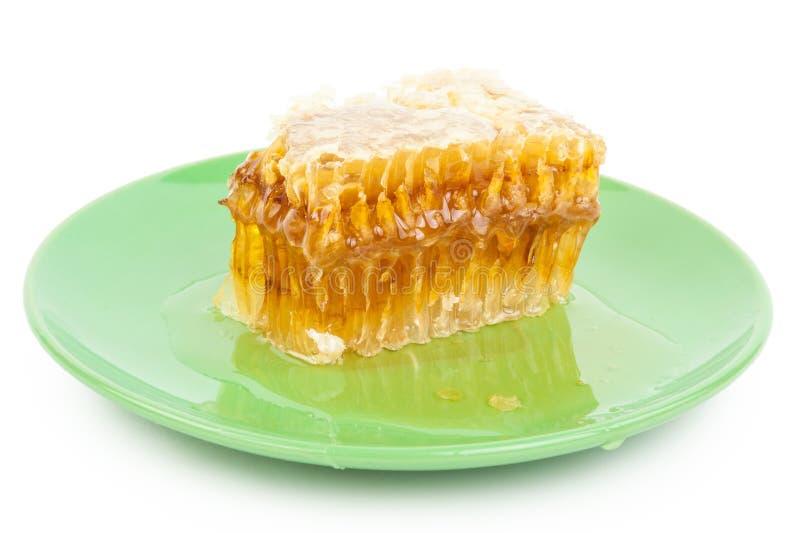 Pente do mel em uma placa fotografia de stock
