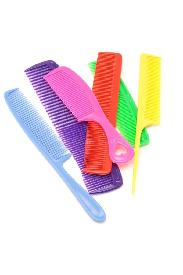 Pentes plásticos coloridos imagens de stock