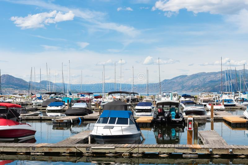 Boats docked at the Penticton Marina and Yacht Club on Okanagan lake royalty free stock photography