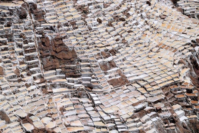 Pentole a terrazze del sale, Perù fotografia stock libera da diritti