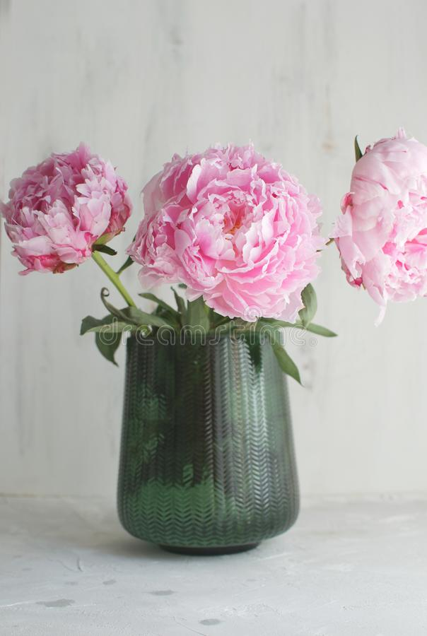 Peonies Flower bouquet Green vase White background Wedding theme Copy space royalty free stock photo