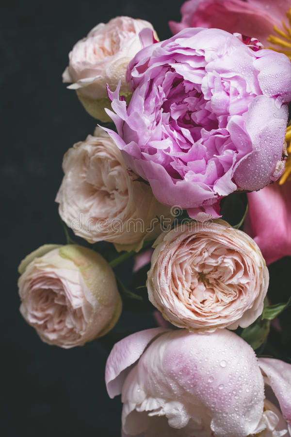 Peonies and roses bouquet. Shabby chic pastel bouquet. Peonies and roses bouquet. Shabby chic pastel colored wedding bouquet. Closeup view, selective focus royalty free stock image