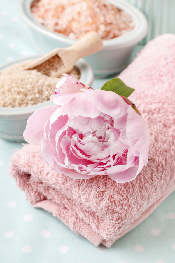 Peony flower on a towel. Relax time royalty free stock photo