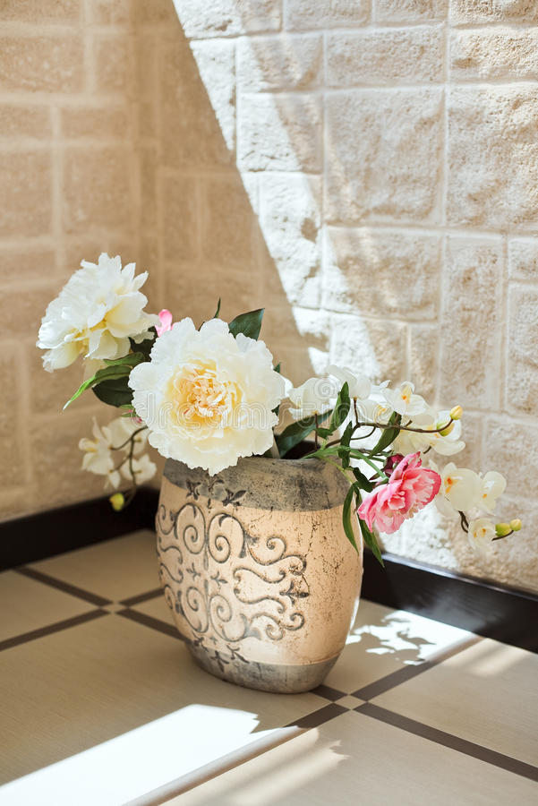 Peony flowers in pottery vase royalty free stock photo