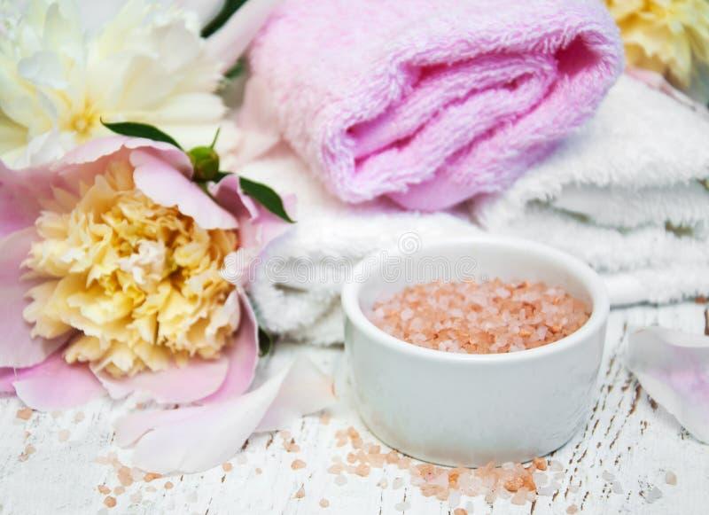 Peony flowers, towel and salt stock photo