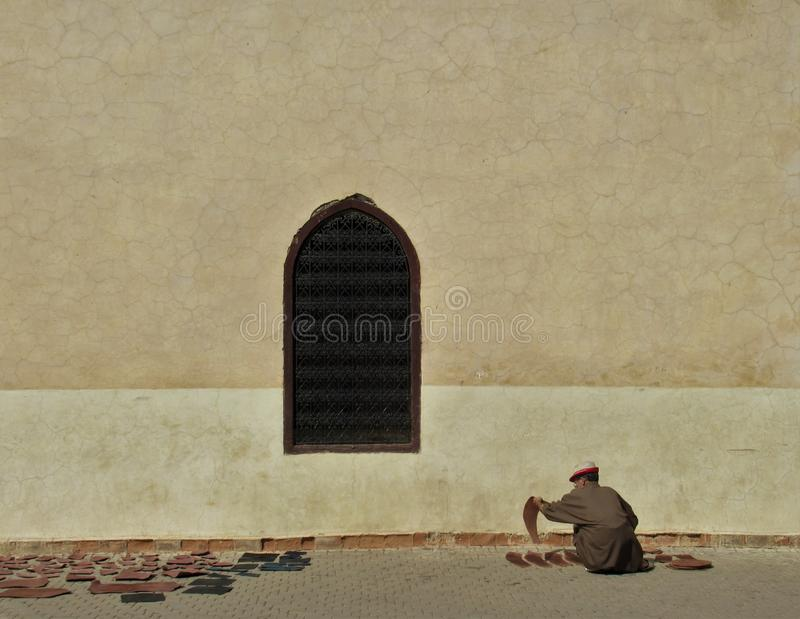 Man working with leather in Marrakesh.  stock photo