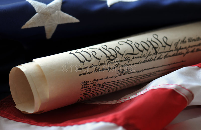 We The People. US Constitution preamble and US flag royalty free stock photography