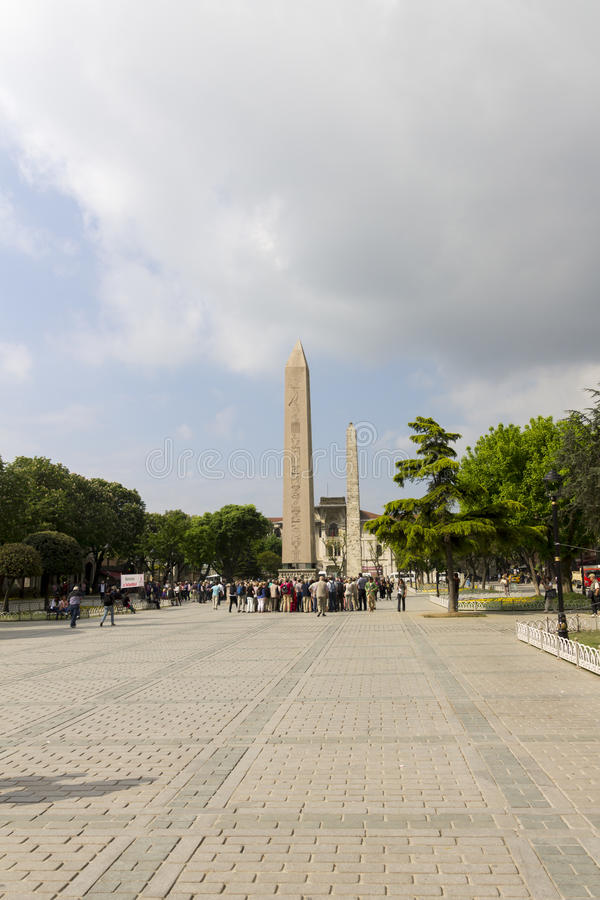 People admiring the Obelisk of Theodosius and Walled obelisk behind it, Istanbul, Turkey stock photos