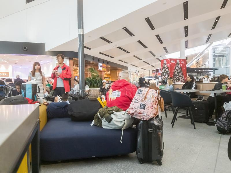 People in airport terminal waiting for departure royalty free stock images