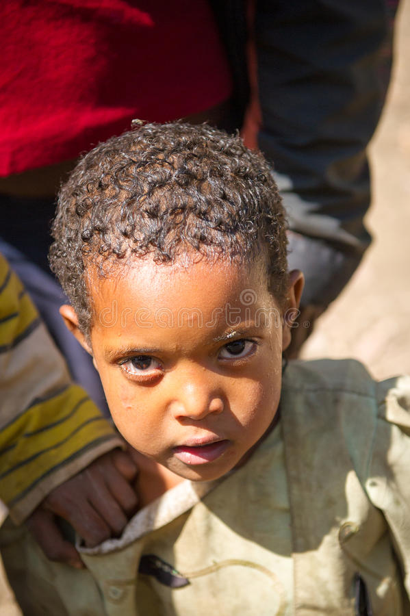 People in AKSUM, ETHIOPIA. AKSUM, ETHIOPIA - SEP 28, 2011: Portrait of an unidentified Ethiopian cute little girl in old clothes in Ethiopia, Sep.28, 2011 royalty free stock images