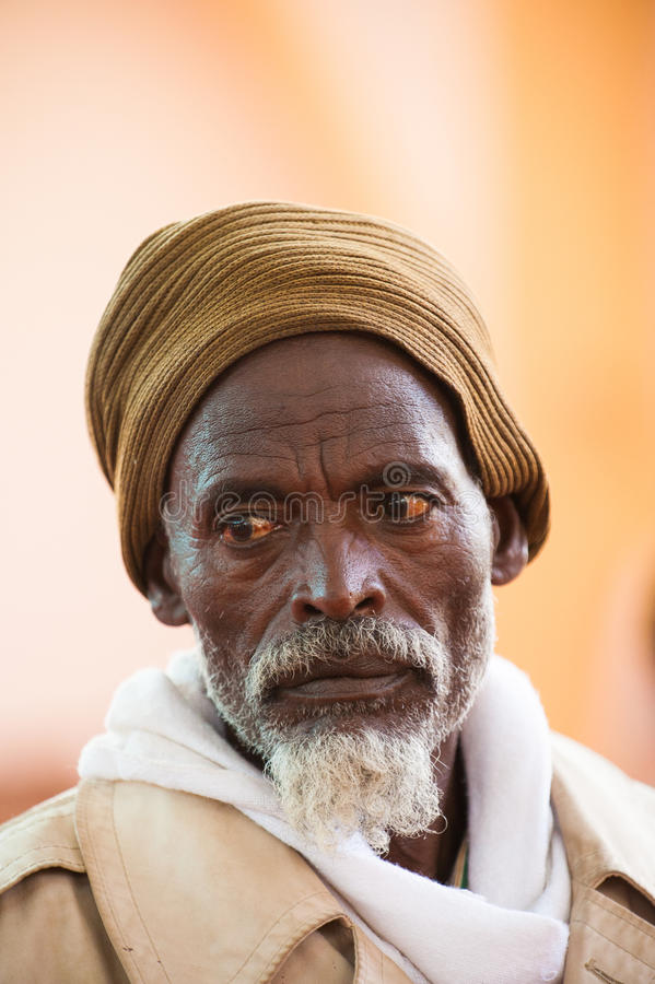 People in AKSUM, ETHIOPIA. AKSUM, ETHIOPIA - SEP 24, 2011: Unidentified Ethiopian man ina yellow hat with white beard in Ethiopia, Sep.24, 2011. People in stock photos