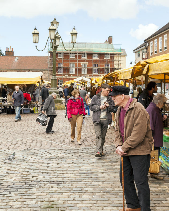 People of all ages shopping at Leek open air market. stock photo