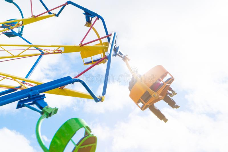 People in amusement park ride. Adult man and with kid in theme park having fun royalty free stock photos