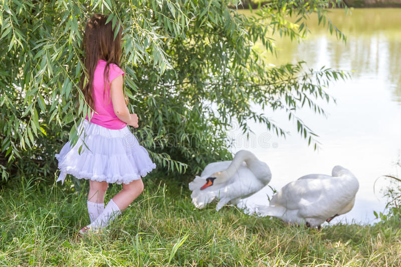 People and animals. Lovely charming kids playing having fun with stock photography