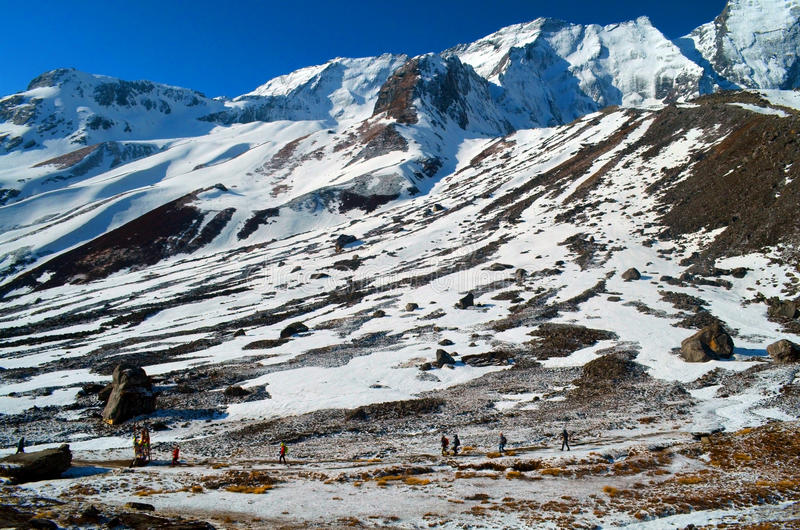 People in Annapurna Base Camp. Mountain Landscape in Himalaya. stock photos