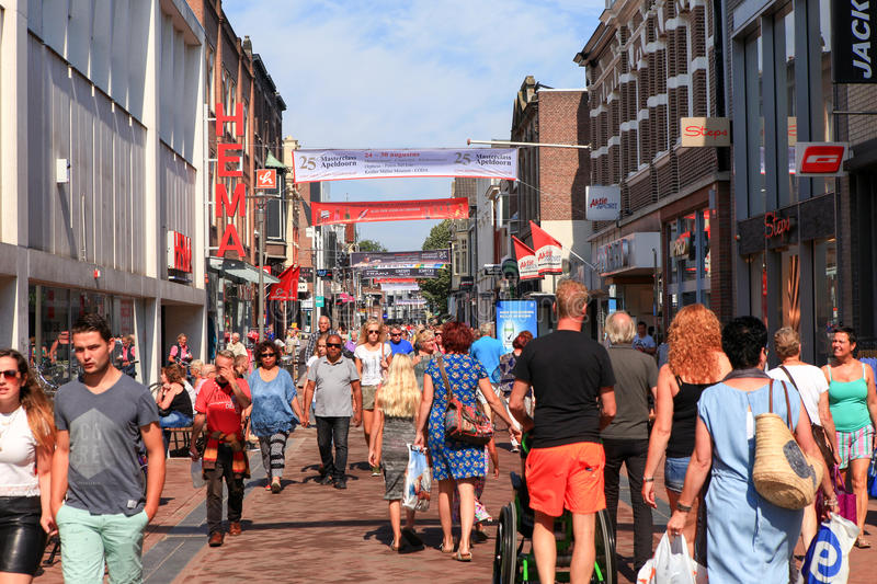 People at Apeldoorn Markstraat main street. Known as a popular shopping street for locals and tourists stock image