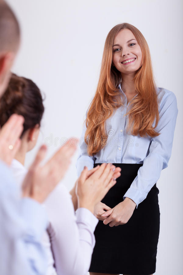 People applaud the girl. For the job interview stock photography