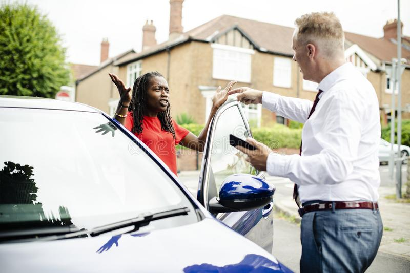 People arguing after a car accident royalty free stock photography