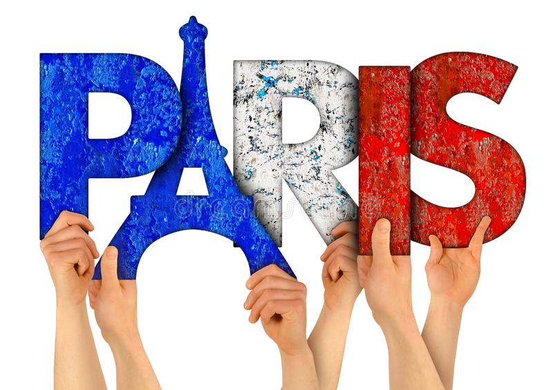 People arms hands holding up wooden letter lettering forming word Paris capital city of france in french national flag colors. People arms hands holding up stock photography