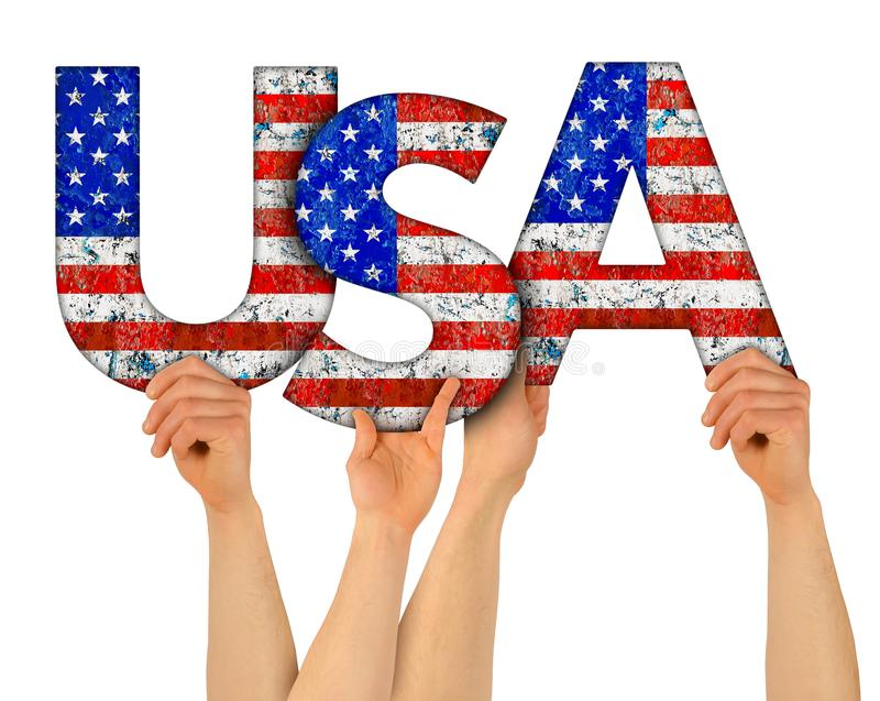 People arms hands holding up wooden letter lettering forming words united states of america USA stars spangled banner national. People arms hands holding up royalty free stock photo