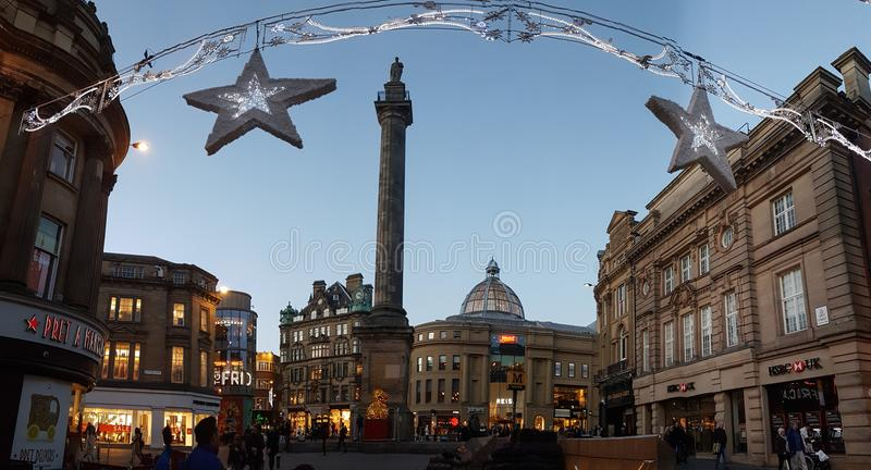 People around Grey`s Monument on Christmas decorated Grey Street. Newcastle, England - December 31, 2017: People around Grey`s Monument on Christmas decorated stock photos