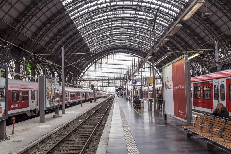 People arrive and depart at Frankfurt train station. FRANKFURT, GERMANY - NOV 4, 2016: people arrive and depart at Frankfurt train station. The classicistic royalty free stock image