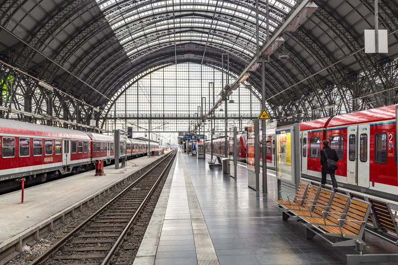 People arrive and depart at Frankfurt train station. FRANKFURT, GERMANY - NOV 4, 2016: people arrive and depart at Frankfurt train station. The classicistic royalty free stock photos