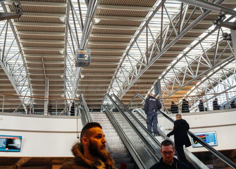 People ascending upper floor of Hamburg Airport royalty free stock image