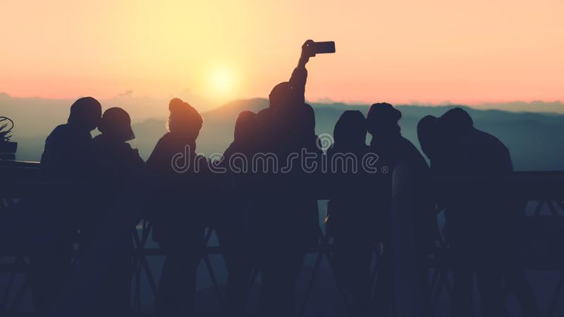 People Asian travel nature. Travel relax. Natural Touch countryside. watch the sun rise. In summer. Group photo with mobile phone. Travel Thailand royalty free stock images