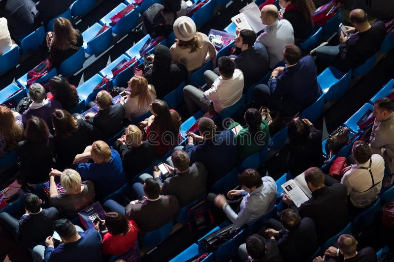 People attend business conference in congress hall royalty free stock photo
