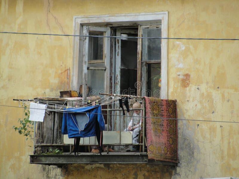 People on balcony of the poor neighborhood. People on the balcony of the poor neighborhood of the poor neighborhood, Russia, Yaroslavl stock image