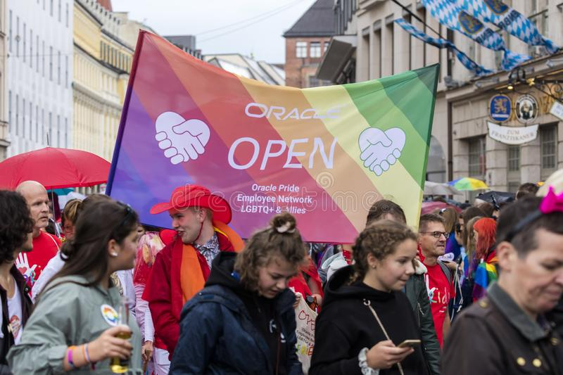 People with banners attending the Gay Pride parade also known as Christopher Street Day CSD in Munich, Germany. 2019: People with banners attending the Gay Pride stock photo